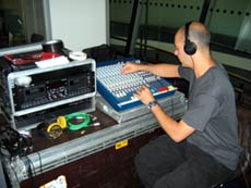 sound technician at mixing desk